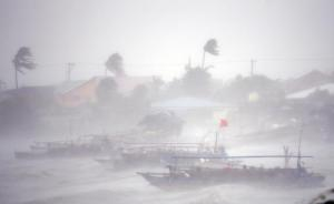 Fishing boats are pictured amid heavy winds and rain brought by Typhoon Rammasun as it hit the town of Imus