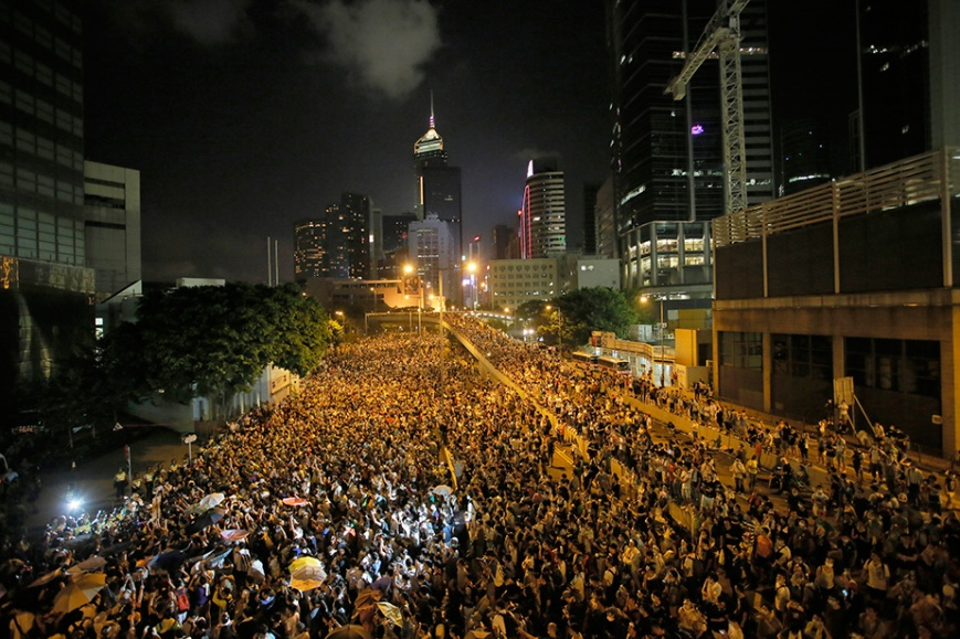 What started as a protest by pro-democracy students escalated into a paralyzing demonstration after riot police tried to clear the streets using tear gas, batons and pepper spray over the weekend. (Photo: Vincent Yu/AP)