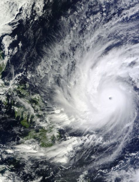 MONSTER STORM. On December 4, 2014, at 02:10 UTC, the MODIS instrument aboard NASA's Terra satellite took this visible image of Super Typhoon Hagupit approaching the Philippines. Image Credit: NASA Goddard's MODIS Rapid Response Team